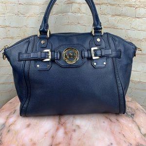 Micheal Kors navy blue hand bag. Gold hardware